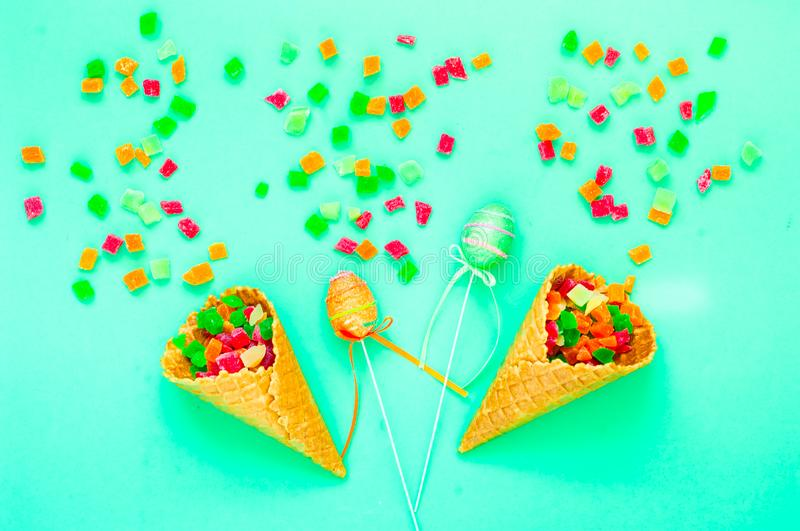 Waffle cones with organic fruits and sweets. Sweetest Day stock photography