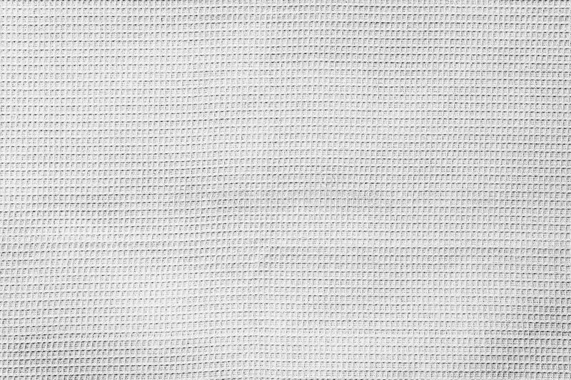 Waffle grey fabric with visible texture copy space for text, web print design elements. Abstract natural cotton texture stock photo