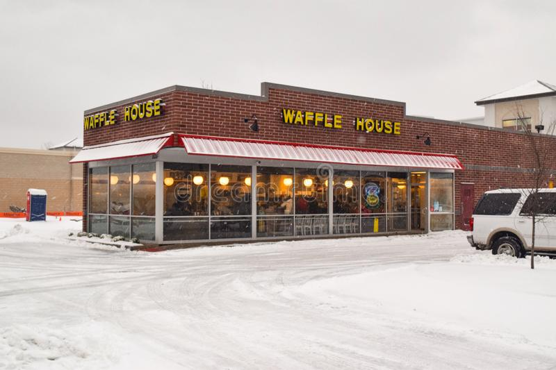Waffle House in the Snow. Waffle House open during snow in Southeast Virginia. The Waffle House Index is an informal way of judging the impact of a storm on a stock image