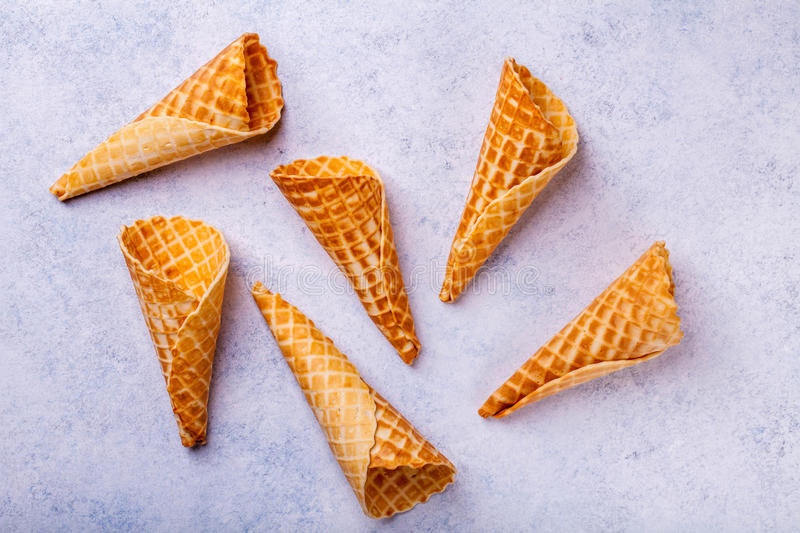 Waffle ice cream cone on a light background stock image
