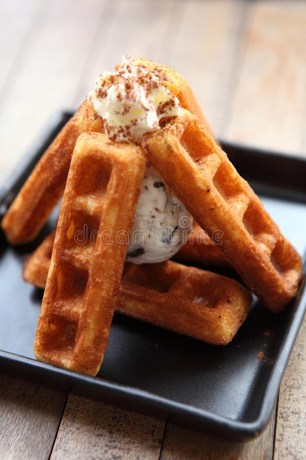 Waffle with ice cream. On wooden table royalty free stock photography