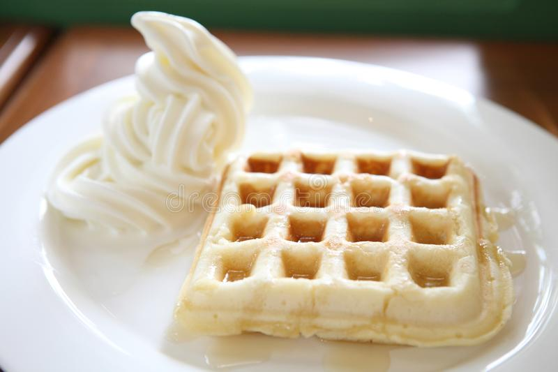 Waffle with ice cream on a plate. In close up stock photo