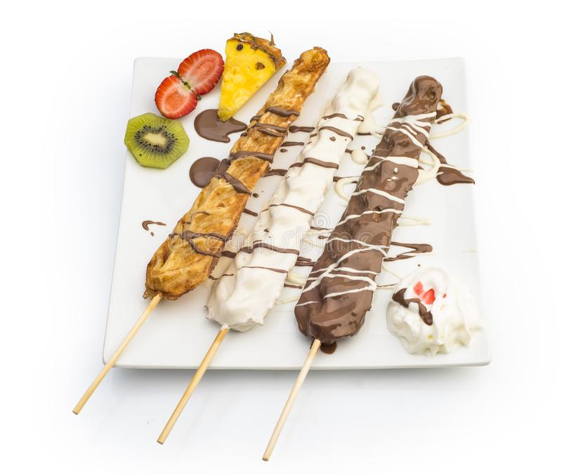 Waffle Sticks dipped with chocolate, Fruits and whipped cream Isolated on white stock images