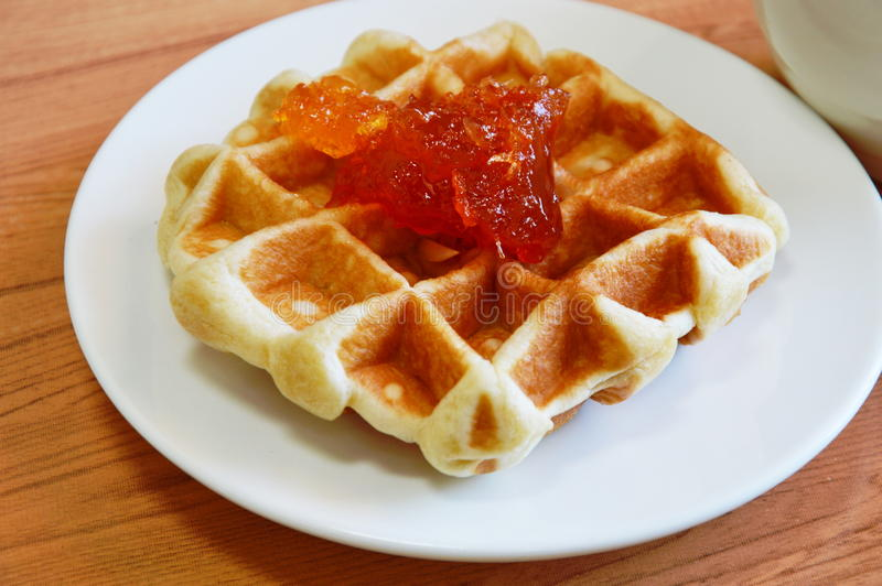 Waffle topping jam in the dish. Baked waffle topping jam in the dish royalty free stock image
