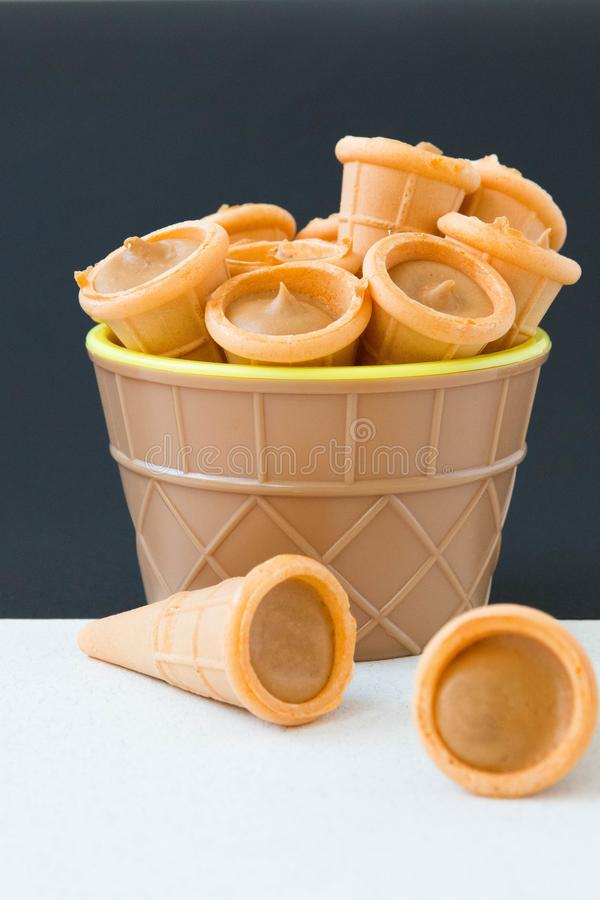 Waffle tubes in an, ice cream cup stock image