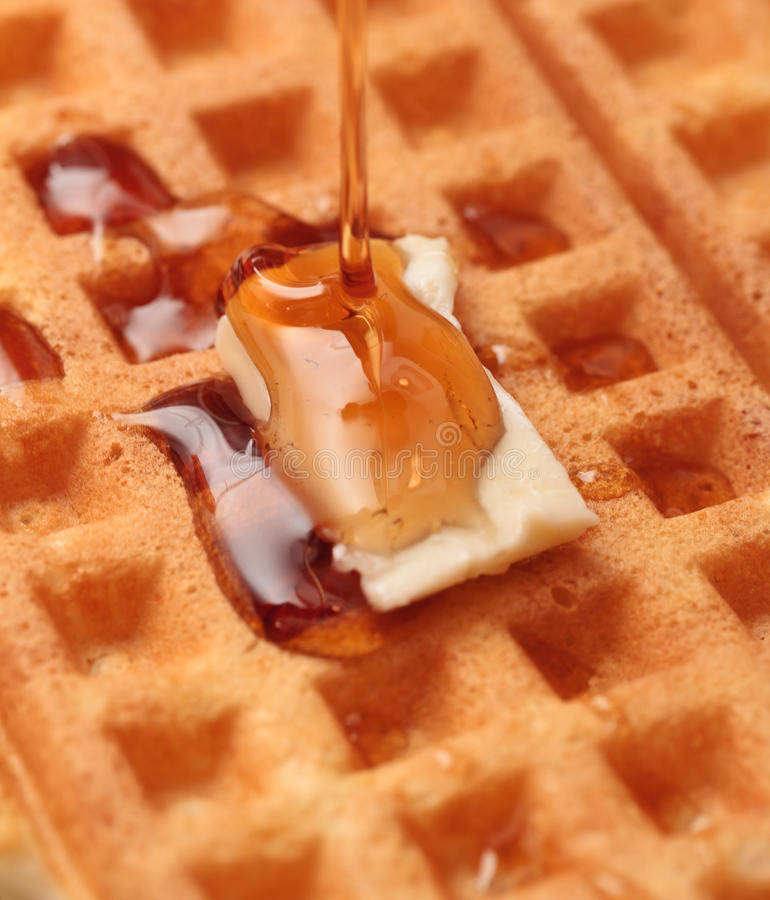 Waffles. Fresh delicious homemade waffles with butter and syrup stock image