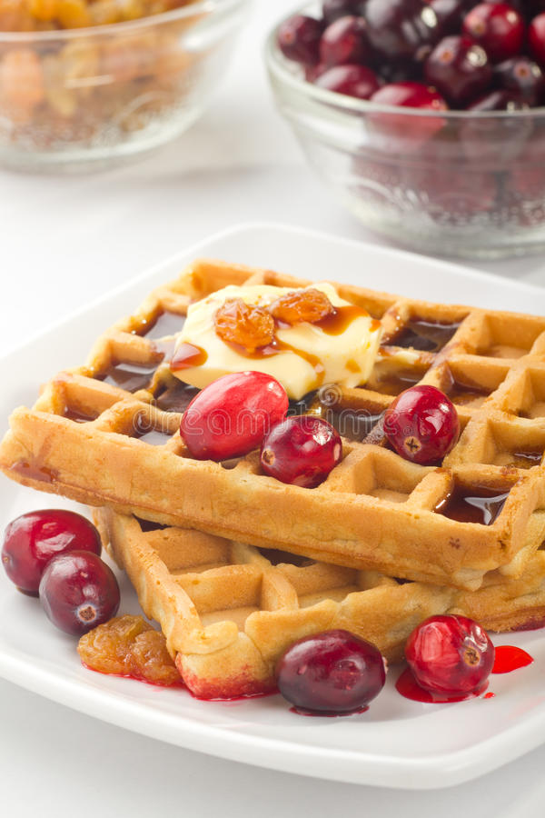 Waffles. A plate of waffles with fresh fruits and honey stock photos