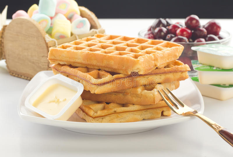 Waffles. A plate of waffles with fresh fruits and butter stock photography