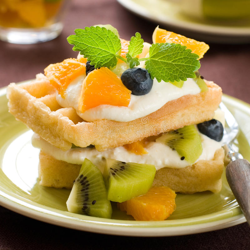 Waffles. With orange and kiwi, selective focus royalty free stock images