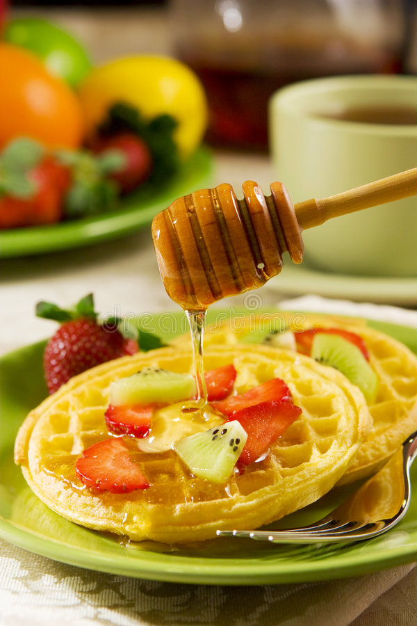Waffles. With fresh fruits and honey stock image