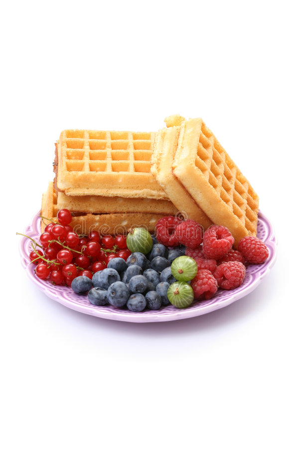 Waffles. Delicious waffles with red currant fruits isolated on white royalty free stock image
