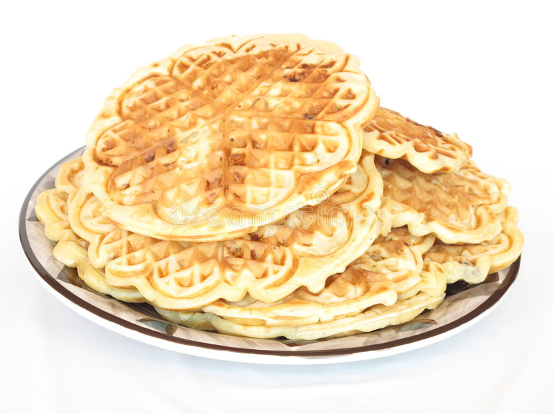 Waffles. Isolated homemade apple and raisin waffles on a ethnic plate royalty free stock image
