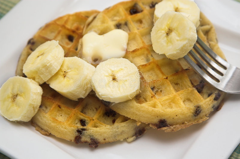 Waffles with banana. Waffles with butter and bananas stock images