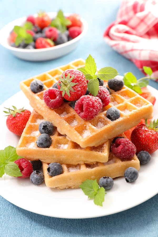 Waffles with berries fruits stock image