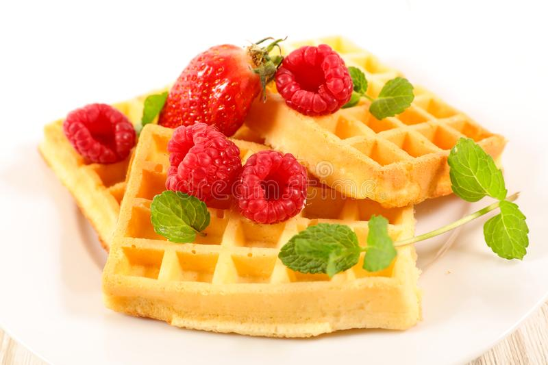 Waffles with berries fruits royalty free stock images