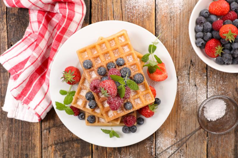 Waffles with berries stock photos