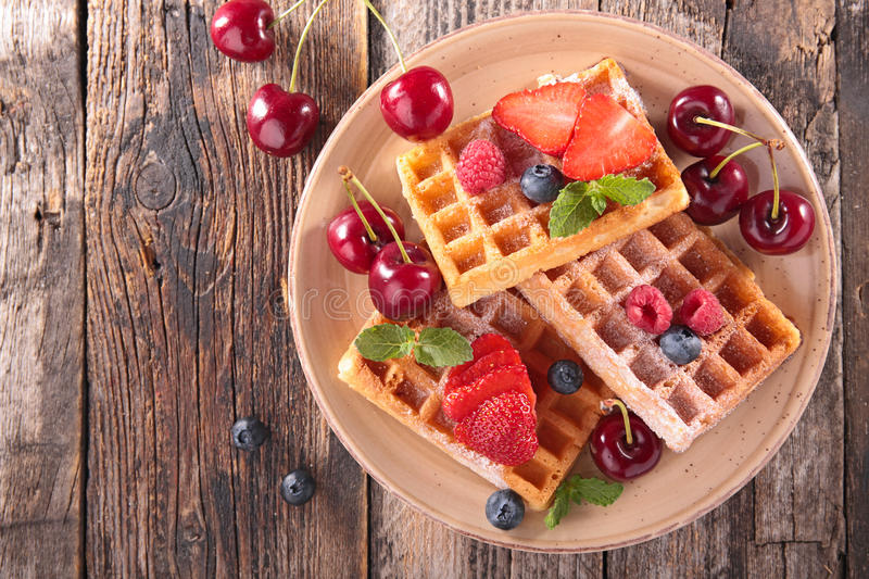 Waffles and berry fruit royalty free stock image