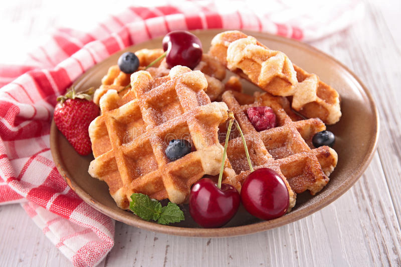 Waffles and berry fruit royalty free stock images