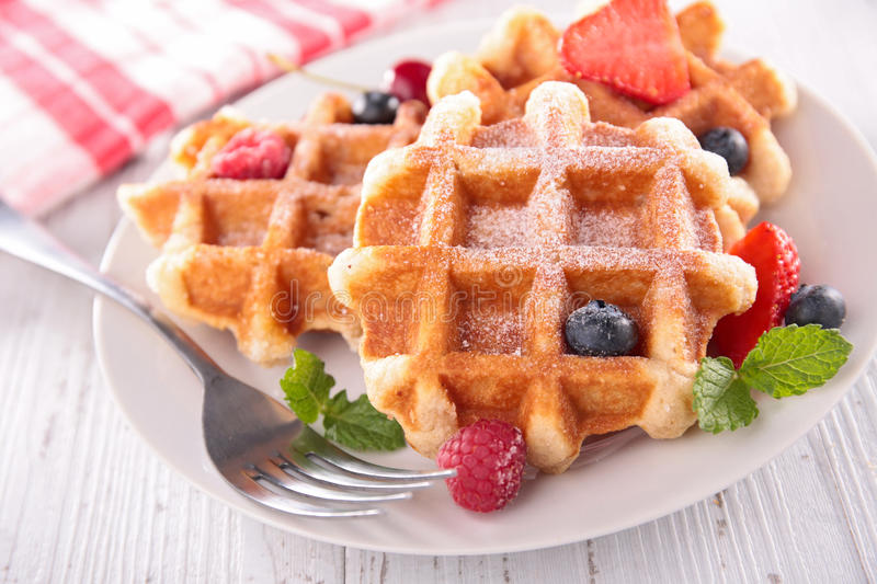 Waffles and berry fruit royalty free stock photos