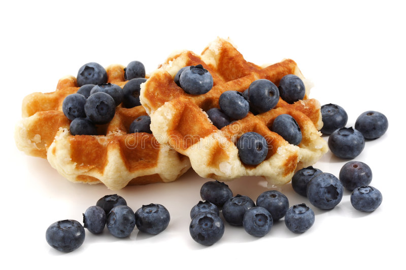 Waffles and blueberries stock image