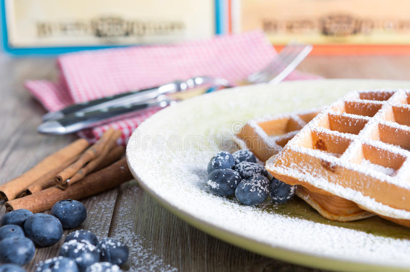 Waffles. With blueberries on a rustic table royalty free stock image