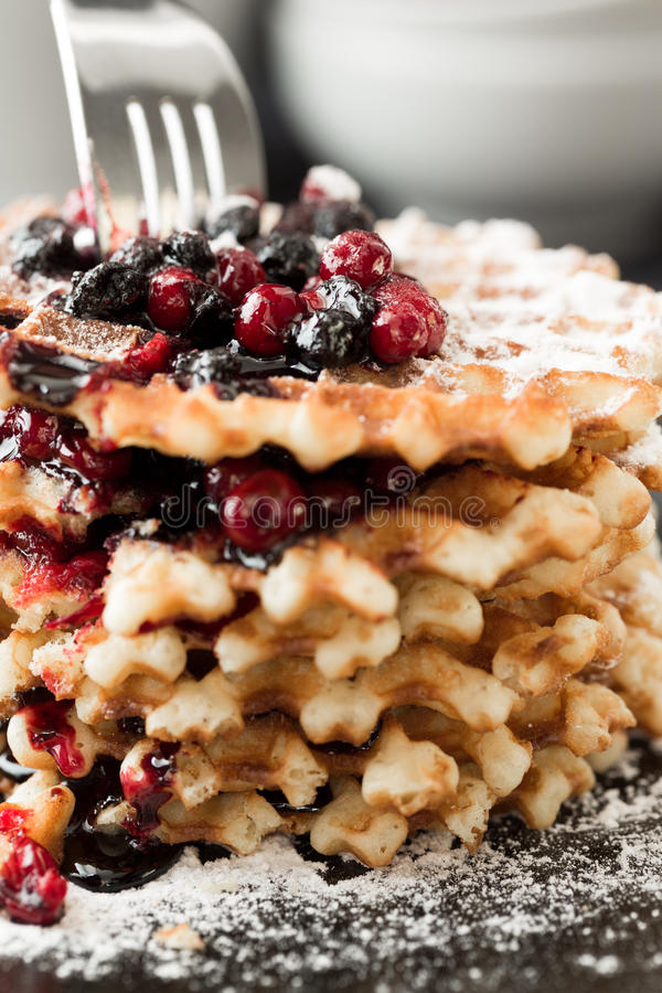 Waffles with blueberry jam and cowberry. Stacked pile stock image