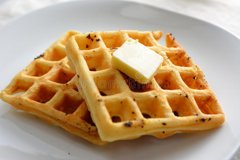 Waffles. A breakfast setting of delicious waffles in the morning stock image