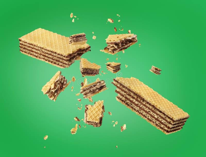 Waffles broken in half. On green royalty free stock photo
