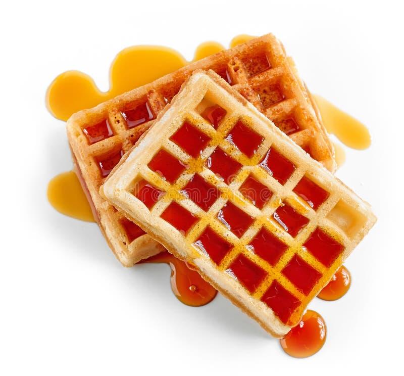 Waffles with caramel sauce royalty free stock photos