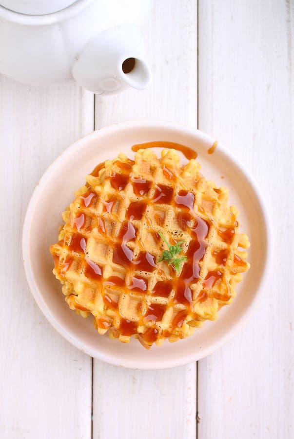 Waffles with caramel sauce royalty free stock image