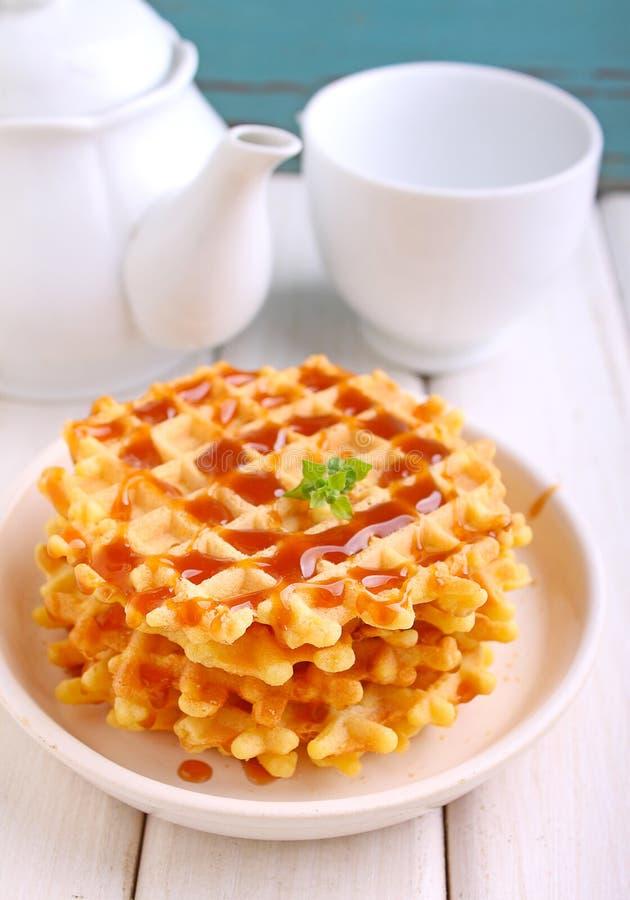 Waffles with caramel sauce royalty free stock photo