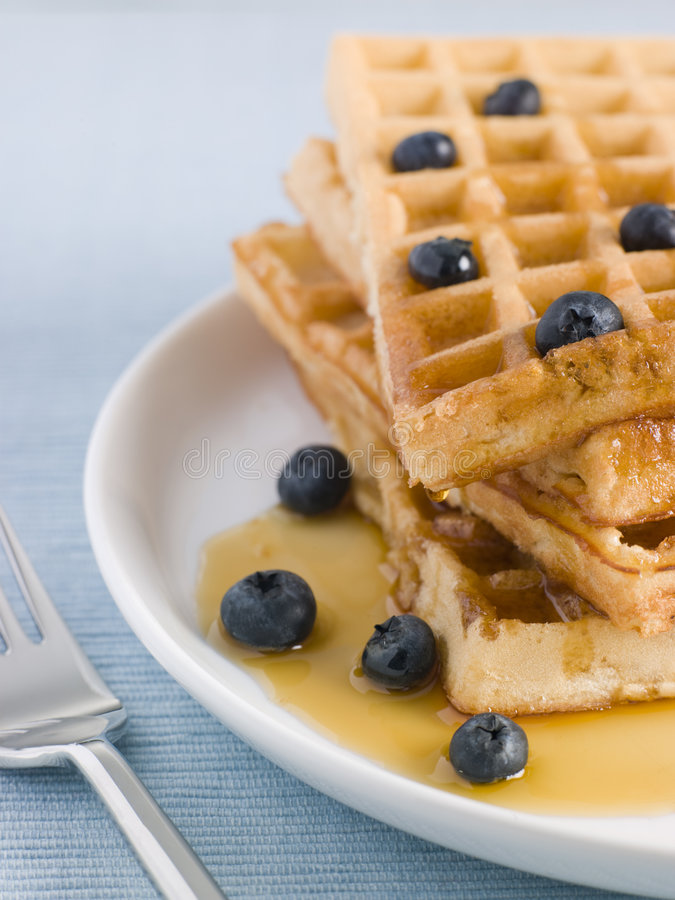 Waffles with Caramel Syrup and Blueberries stock photos