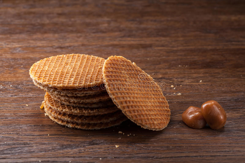 Waffles with caramel on wood. En background. Top view stock images