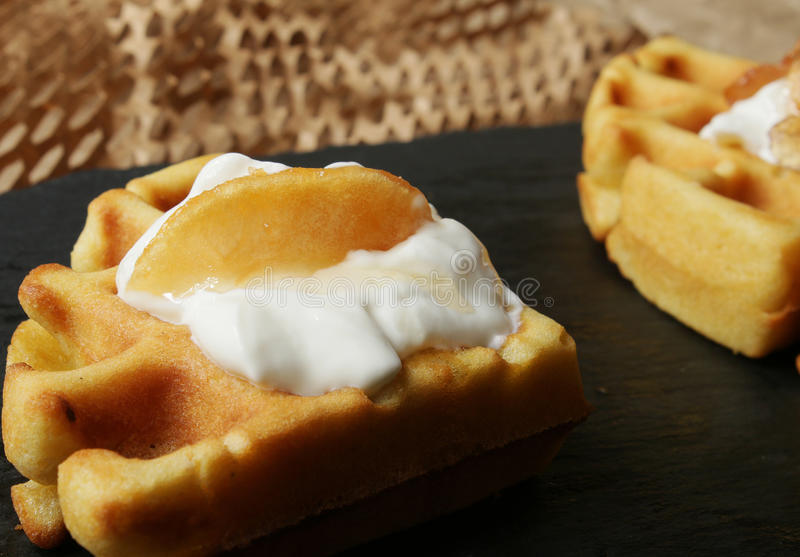 Waffles. With cream and apple jam stock image