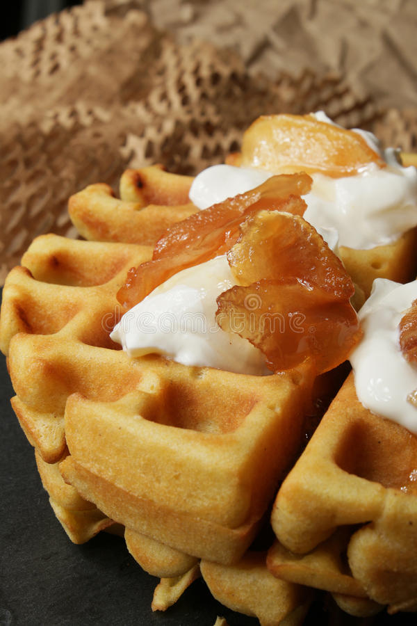 Waffles. With cream and apple jam stock photography