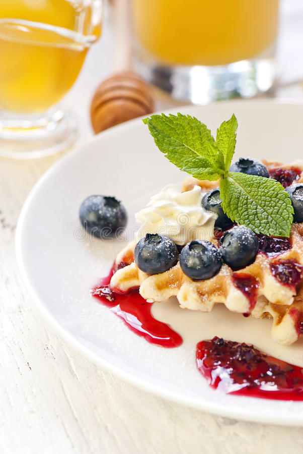Waffles with cream and berries stock photography