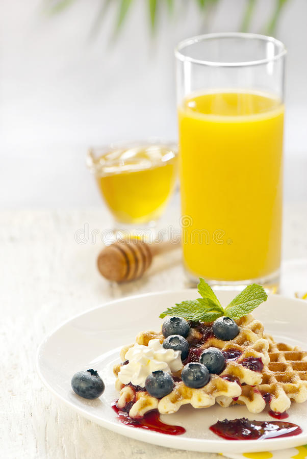 Waffles with cream and berries royalty free stock images