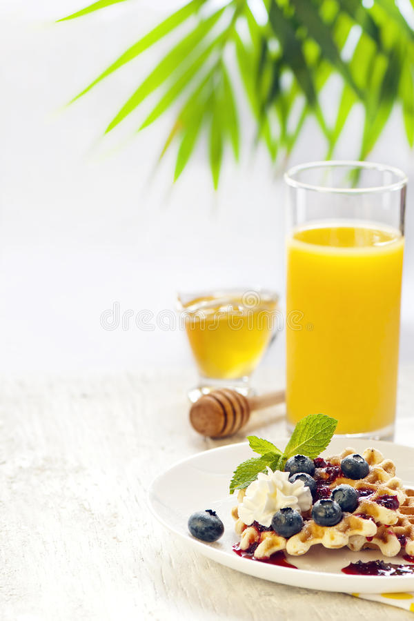 Waffles with cream and berries royalty free stock photos
