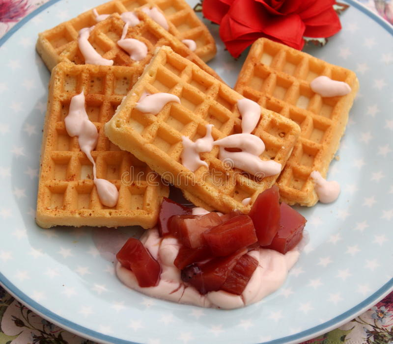 Waffles. A dessert of waffles with yogurt and fruits stock photography