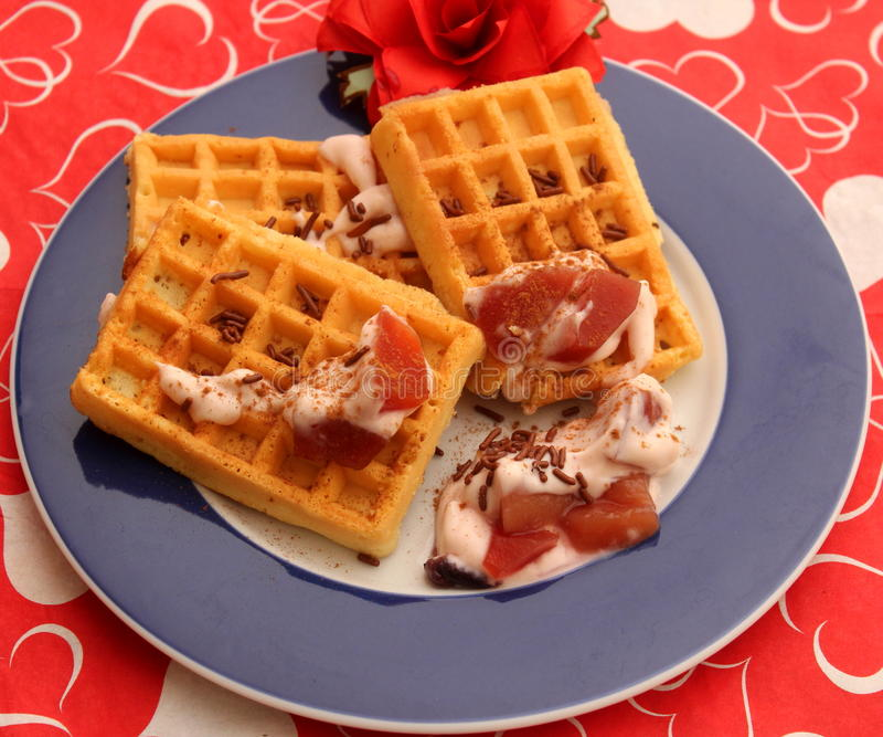 Waffles. A dessert of waffles with yogurt and fruits royalty free stock images