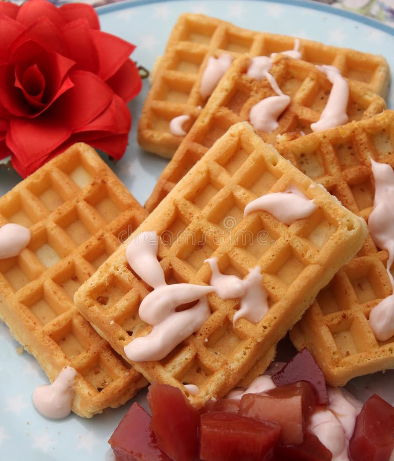Waffles. A dressert of waffles with yogurt and fruits royalty free stock photos