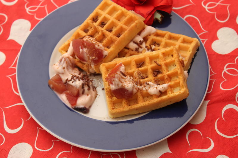 Waffles. A dressert of waffles with yogurt and fruits royalty free stock images