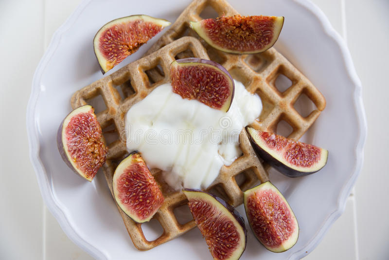 Waffles with fresh figs. And clotted cream royalty free stock photo
