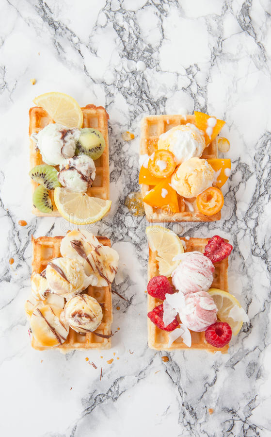 Waffles with fresh fruits stock images