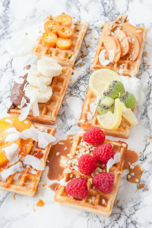 Waffles with fresh fruits stock photo