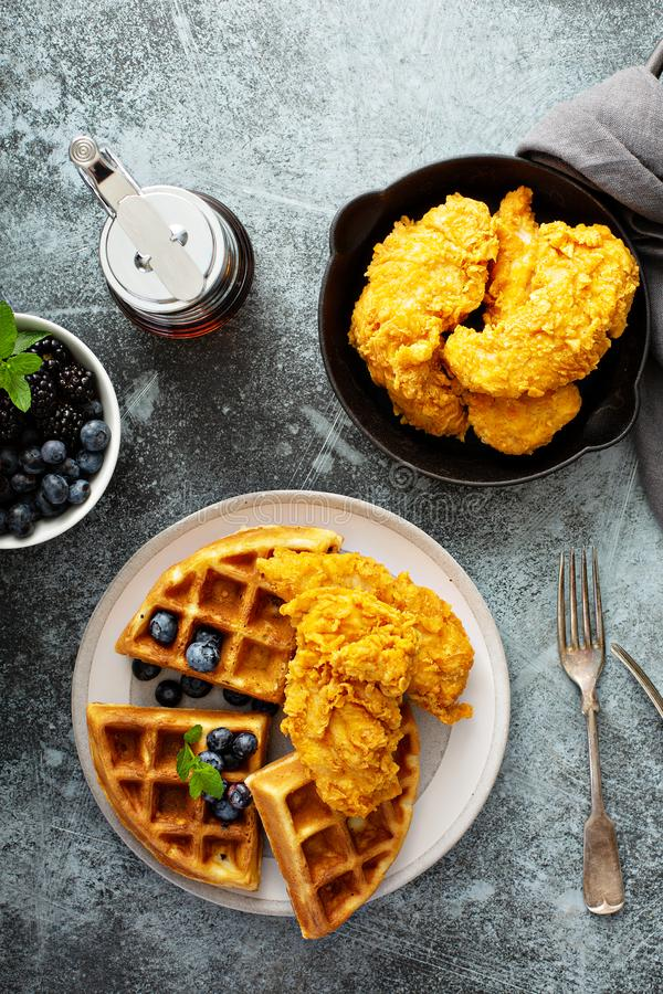 Waffles with fried chicken. And maple syrup, southern comfort food royalty free stock image
