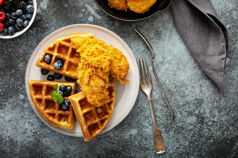 Waffles with fried chicken. And maple syrup, southern comfort food royalty free stock photo