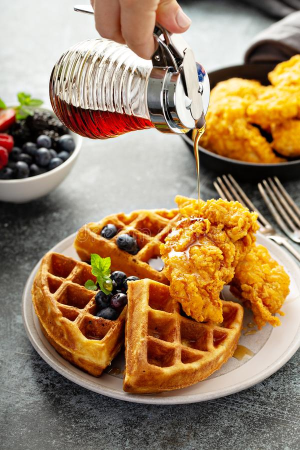 Waffles with fried chicken. And maple syrup, southern comfort food stock photography