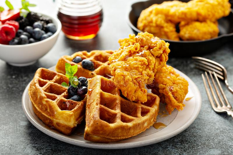Waffles with fried chicken. And maple syrup, southern comfort food stock image