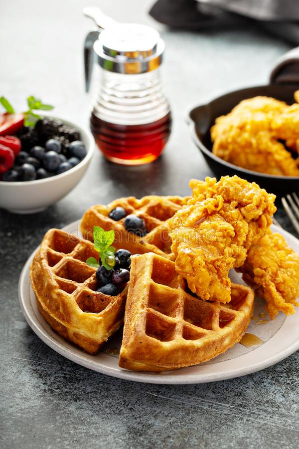 Waffles with fried chicken. And maple syrup, southern comfort food stock photo